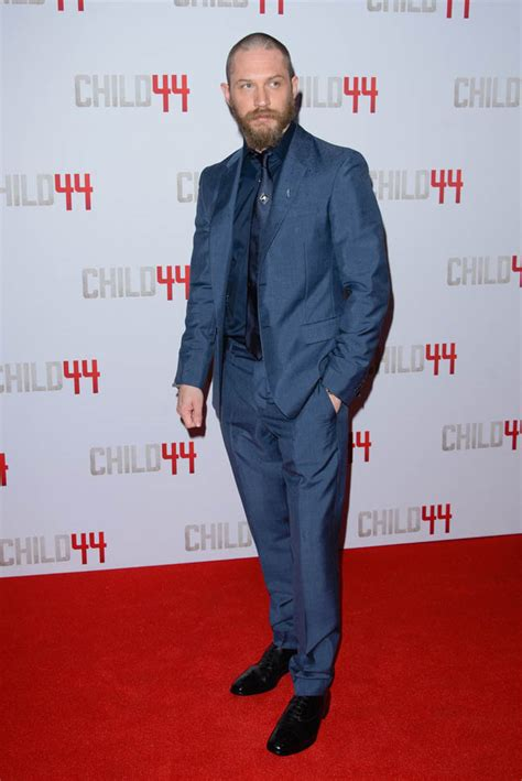 Tom Hardy in well-tailored suit with Noomi Rapace at the